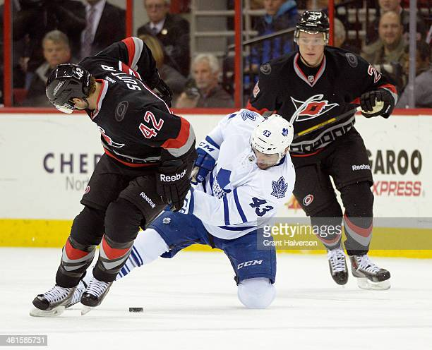 Nazem Kadri of the Toronto Maple Leafs battles for the puck with Brett Sutter of the Carolina Hurricanes during a game at PNC Arena on January 9,...