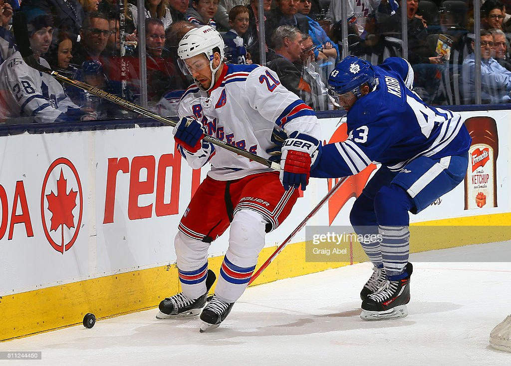 Nazem Kadri #43 of the Toronto Maple Leafs chases Derek Stepan #21 of the New York Rangers during NHL game action on February 18, 2016 at Air Canada Centre in Toronto, Ontario, Canada.