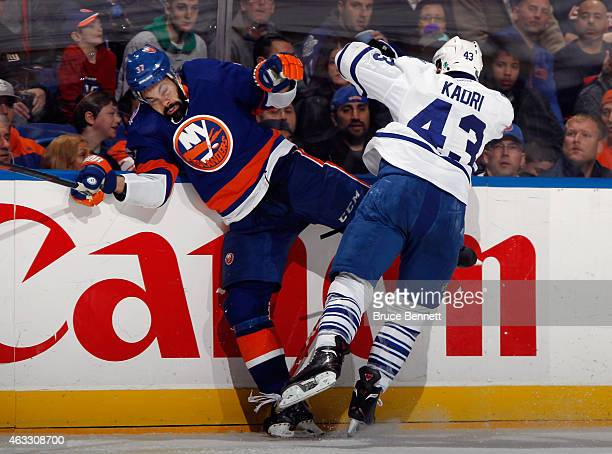 Nazem Kadri of the Toronto Maple Leafs checks Brian Strait of the New York Islanders during the third period at the Nassau Veterans Memorial Coliseum...