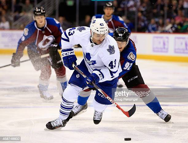 Nazem Kadri of the Toronto Maple Leafs controls the puck against Gabriel Landeskog of the Colorado Avalanche at Pepsi Center on November 6 2014 in...