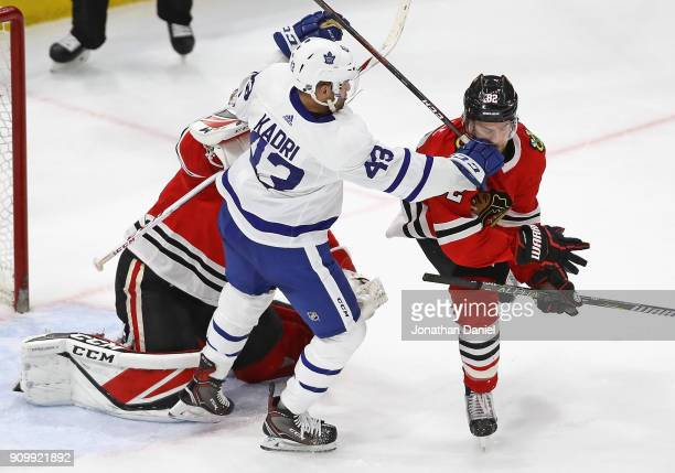 Nazem Kadri of the Toronto Maple Leafs hits Jordan Oesterle of the Chicago Blackhawks in the mouth in front of Jeff Glass at the United Center on...