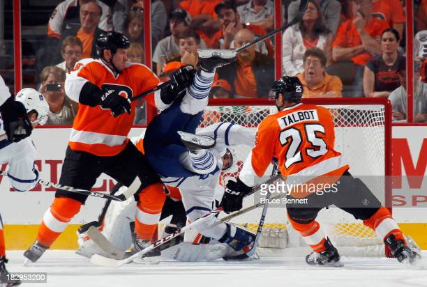 Nazem Kadri of the Toronto Maple Leafs is flipped into the net by Nicklas Grossmann of the Philadelphia Flyers at the Wells Fargo Center on October...