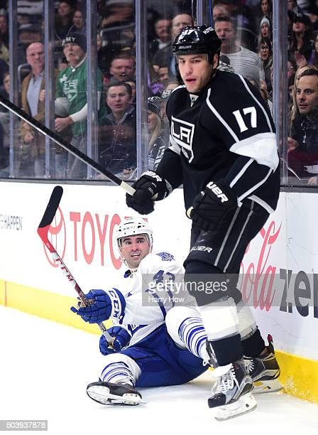Nazem Kadri of the Toronto Maple Leafs reacts from the ice after a check from Milan Lucic of the Los Angeles Kings during the first period at Staples...