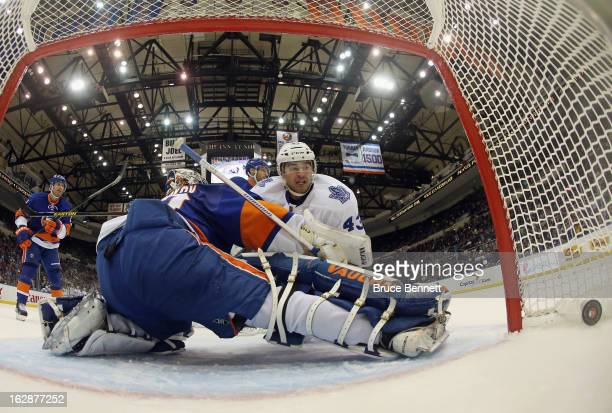 Nazem Kadri of the Toronto Maple Leafs scores a hatrick at 14:12 of the second period against Evgeni Nabokov of the New York Islanders at the Nassau...