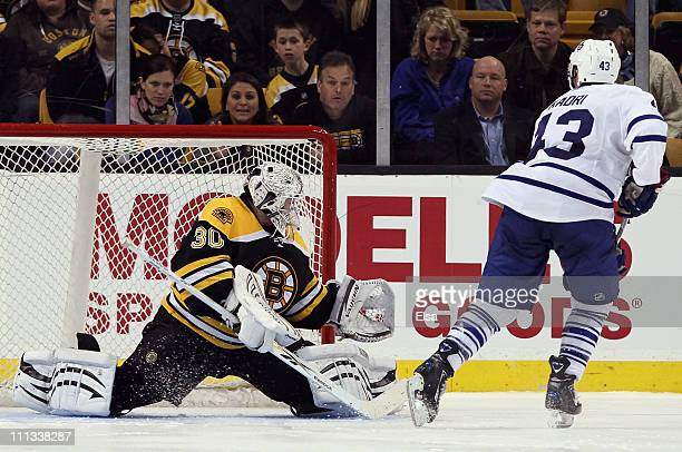 Nazem Kadri of the Toronto Maple Leafs shoots the game winner past Tim Thomas of the Boston Bruins on March 31, 2011 at the TD Garden in Boston,...