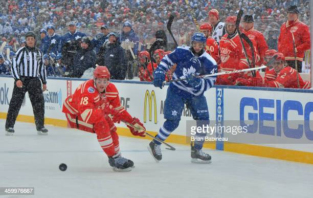 Nazem Kadri of the Toronto Maple Leafs shoots the puck past Joakim Andersson of the Detroit Red Wings into the Wings zone in the first period during...