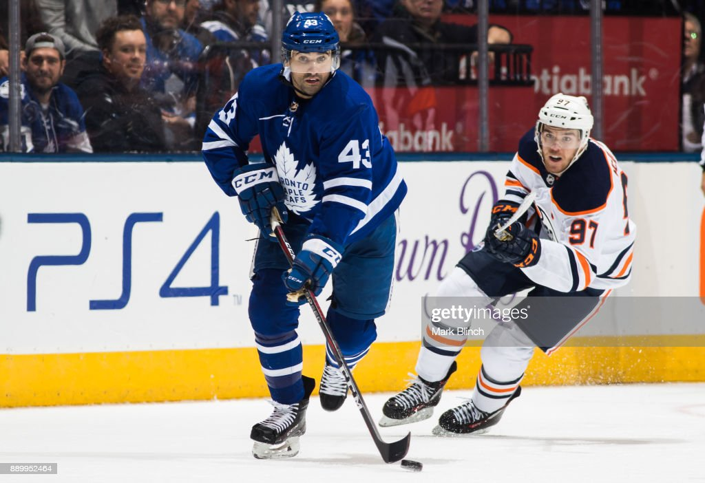 Nazem Kadri #43 of the Toronto Maple Leafs skates against Connor McDavid #97 of the Edmonton Oilers during the third period at the Air Canada Centre on December 10, 2017 in Toronto, Ontario, Canada.