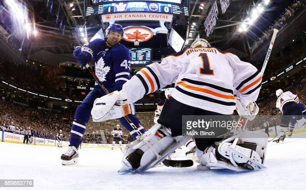 Nazem Kadri of the Toronto Maple Leafs skates in on Laurent Brossoit of the Edmonton Oilers during the first period at the Air Canada Centre on...
