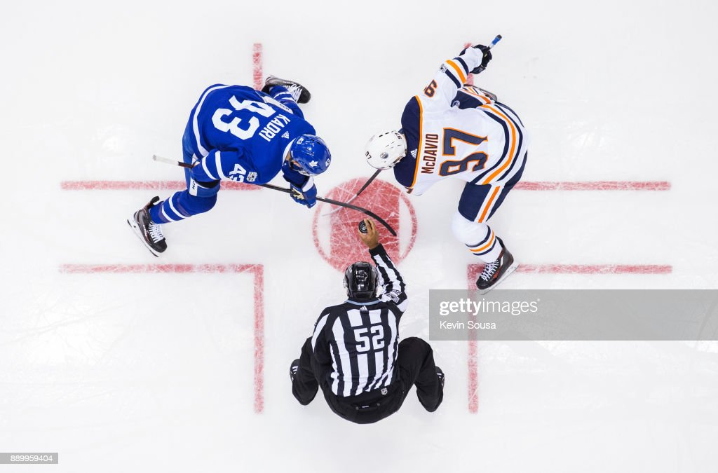Nazem Kadri #43 of the Toronto Maple Leafs takes a face-off against Connor McDavid #97 of the Edmonton Oilers during the third period at the Air Canada Centre on December 10, 2017 in Toronto, Ontario, Canada.