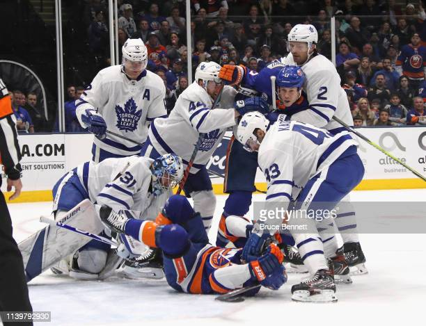 Nazem Kadri of the Toronto Maple Leafs takes a second period roughing penalty against Cal Clutterbuck of the New York Islanders at NYCB Live's Nassau...