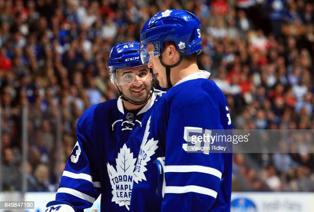 Nazem Kadri of the Toronto Maple Leafs talks with Jake Gardiner during an NHL game against the Detroit Red Wings at Air Canada Centre on March 7 2017...