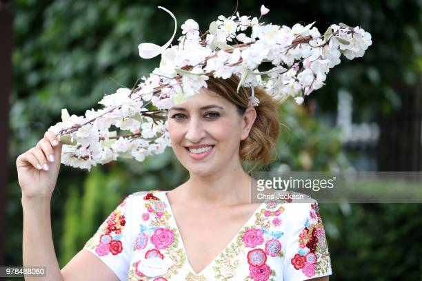 Nazer Bullen wears a hat with white flowers during Royal Ascot Day 1 at Ascot Racecourse on June 19 2018 in Ascot United Kingdom