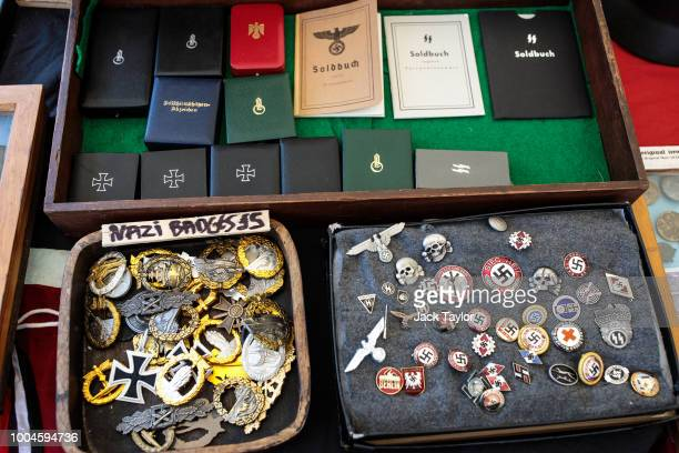 Nazi badges for sale at a stall during the annual War and Peace Revival show at Hop Farm Country Park on July 24 2018 in Maidstone England The...
