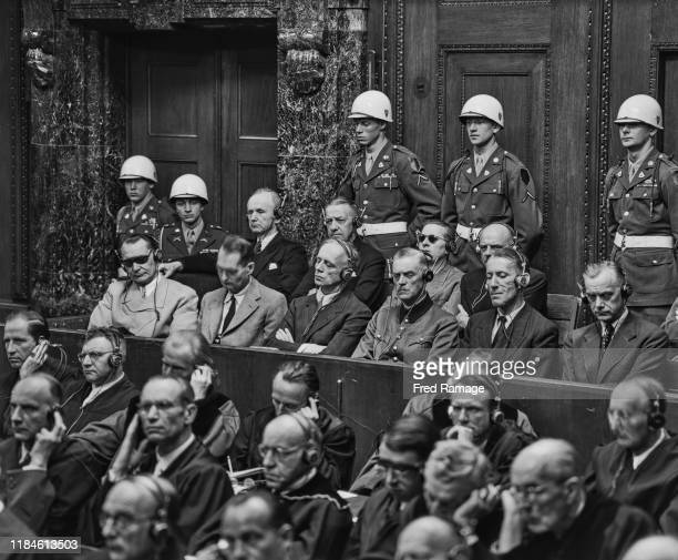 Nazi defendant Hermann Goering in the dock behind the defence counsel under guard in Room 600 at the Palace of Justice in Nuremberg during legal...