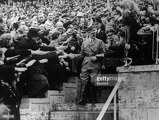 Nazi dictator Adolf Hitler greets supporters at a May Day gathering in the Olympic Stadium Berlin