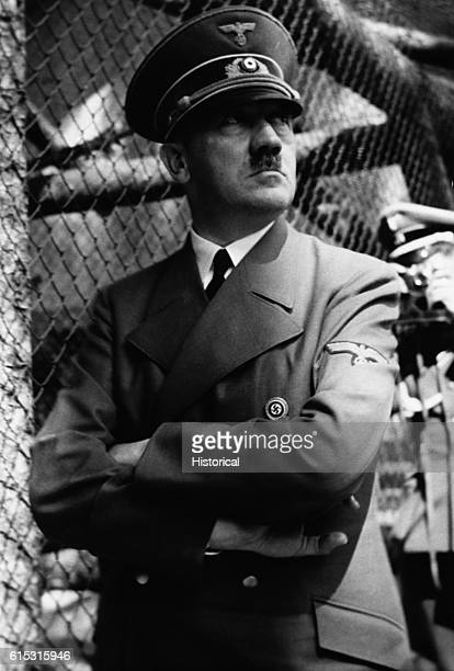 Nazi dictator Adolph Hitler in front of zoo cage