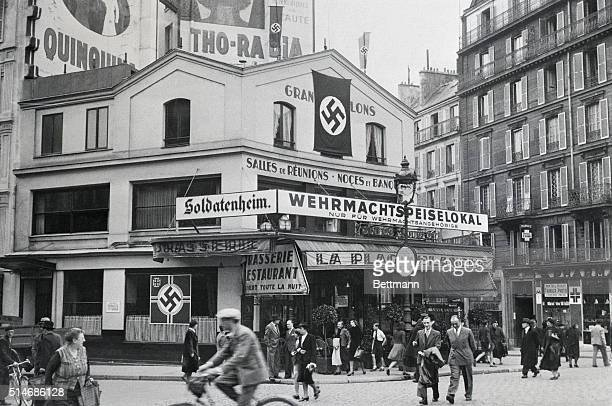 Nazi flags and German signs festoon La Place Blanche the cafe across from the Moulin Rouge in 1940 The cafe was reserved for exclusive use by...