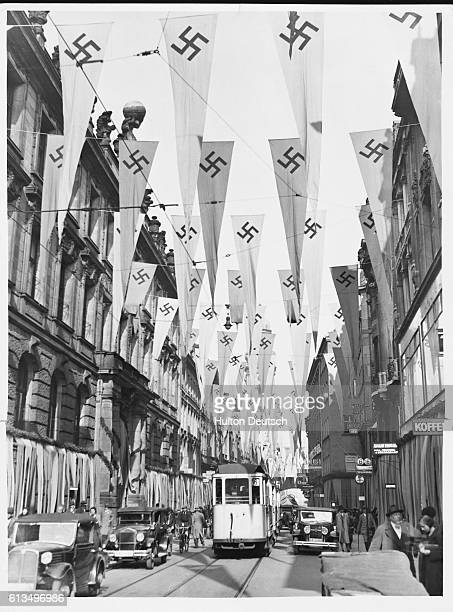 Nazi flags flying over a street in Munich in Germany ca 1935
