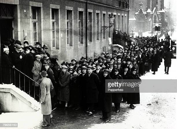 13th January 1935 The Saar Plebiscite Voters line up in the snow in Crown Prince Strasse Saarbrucken to vote on whether Saarland should be returned...