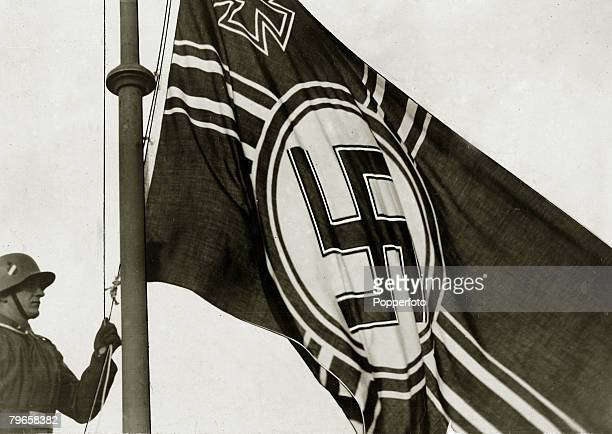 1930's The German swastika is raised symbol of Nazi Germany