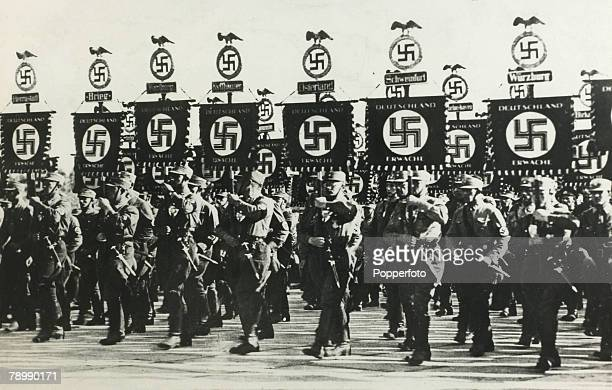 circa 1938 Brown shirts marching with swastika banners at a rally at Nuremberg
