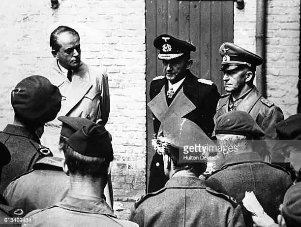 Nazi Grand Admiral Karl Doenitz General Jodl and Nazi architect Albert Speer are interviewed by Allied war correspondents