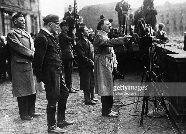 Nazi ideologue Joseph Goebbels stands beside Adolf Hitler as Hitler delivers a 1932 election speech. Hitler lost the 1932 presidential election to...