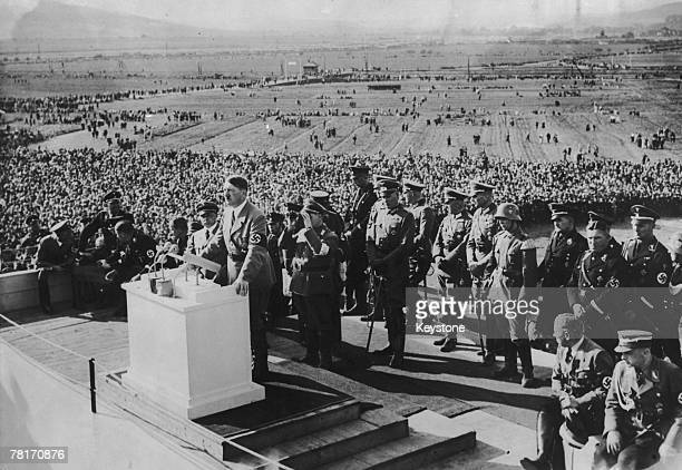 Nazi leader Adolf Hitler addresses crowds of agricultural workers at Bueckeburg Hill in Hanover during a harvest thanksgiving festival 7th October...