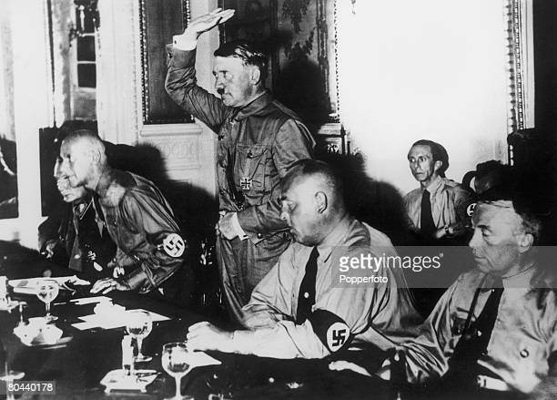 Nazi leader Adolf Hitler administering an oath to a meeting of 230 Nazi members of the German Reichstag in Berlin 31st August 1932 From left to right...