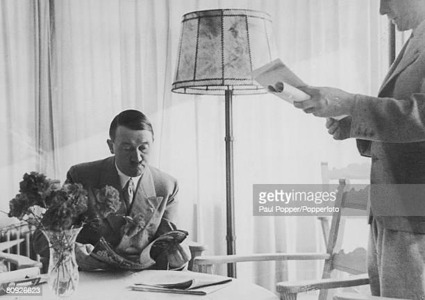 Nazi leader Adolf Hitler at breakfast circa 1935