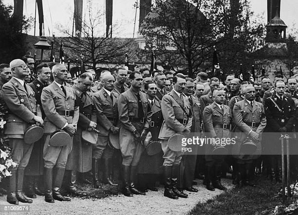 Nazi leader Adolf Hitler at the funeral of his chauffeur Julius Schreck at Grafelfing near Munich, 20th May 1936. Schreck was a Nazi party member and...