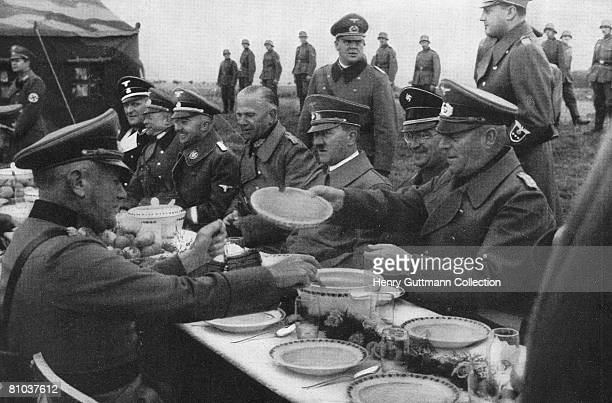 Nazi leader Adolf Hitler dines alfresco with a group of generals circa 1940 With him is SS leader Heinrich Himmler