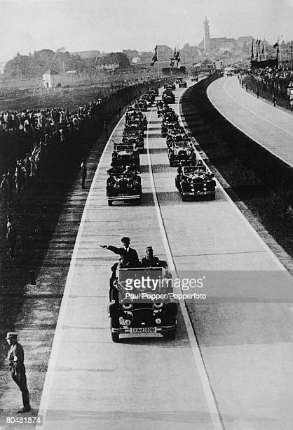 Nazi leader Adolf Hitler heads a motorcade at the opening of a new autobahn circa 1935