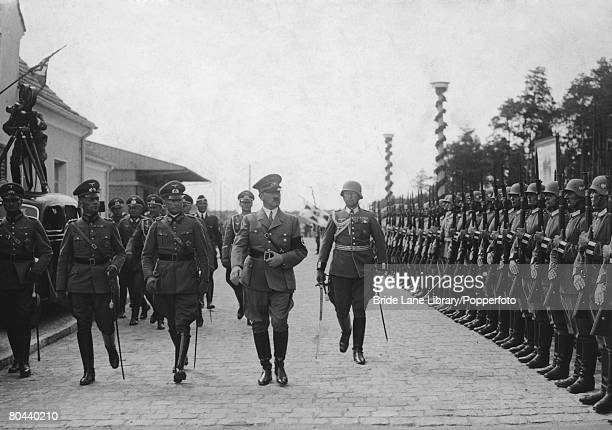 Nazi leader Adolf Hitler inspecting a guard of honour at a military training camp at Gross Born on 22nd August 1938 four days after he officially...