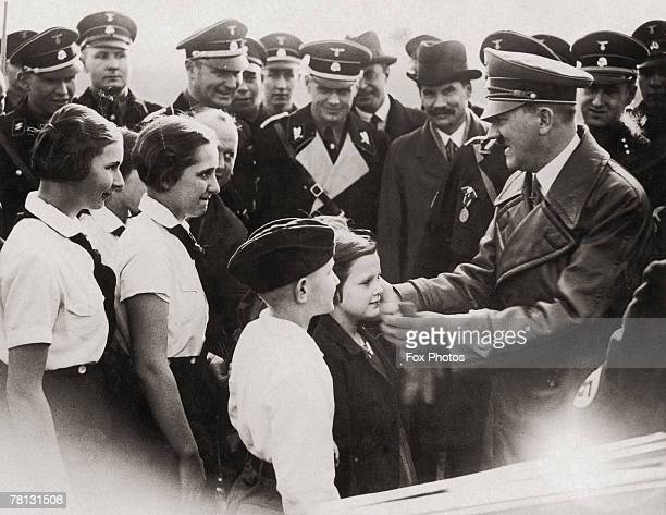 Nazi leader Adolf Hitler meets a group of young admirers in Breslau March 1936 Looking on is German diplomat and future Ambassador to Britain Joachim...