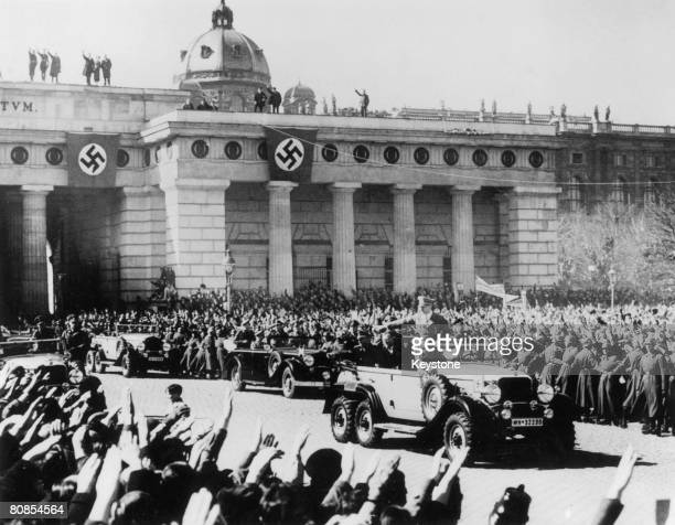 Nazi leader Adolf Hitler reviews his troops during the victory parade in Vienna following the German annexation of Austria 16th March 1938