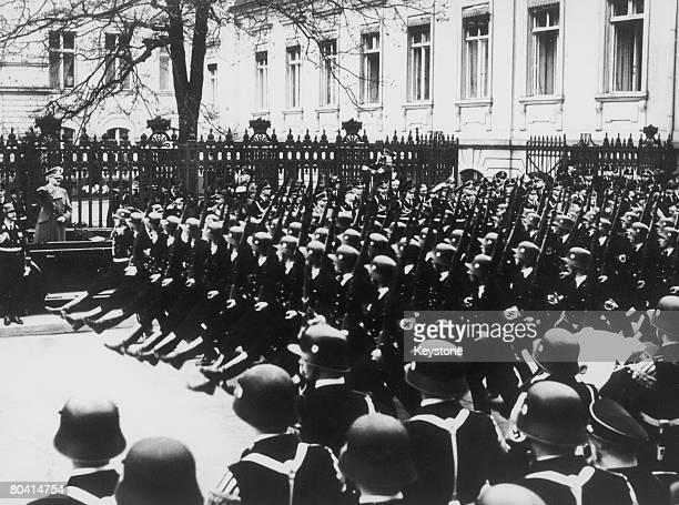 Nazi leader Adolf Hitler salutes SS soldiers parading in Wilhelmstrasse Berlin on the occasion of Hitler's 50th birthday 20th April 1939