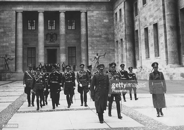 Nazi leader Adolf Hitler shows a group of military officers around the New Reich Chancellery Berlin 1939 The newlybuilt Chancellery was designed by...