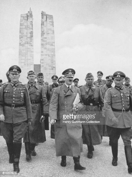 Nazi leader Adolf Hitler visits the First World War memorial to the Canadian soldiers killed at Vimy Ridge France circa 1940 With him is Wehrmacht...