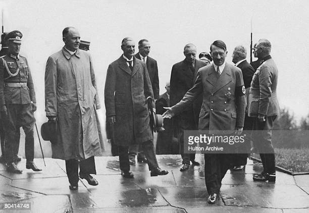Nazi leader Adolf Hitler with British Prime Minister Neville Chamberlain during Chamberlain's visit to Munich which led to the Munich Agreement...
