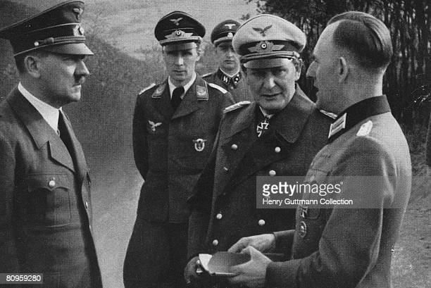 Nazi leader Adolf Hitler with commander in chief of the Luftwaffe Hermann Goering and Hitler's Chief adjutant Lieutenant Colonel Rudolf Schmundt...