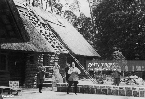 Nazi leader Adolf Hitler with friends at Goering's chalet on the Obersalzberg 100 metres above the Berghof circa 1935 From left to right Hitler Emmy...