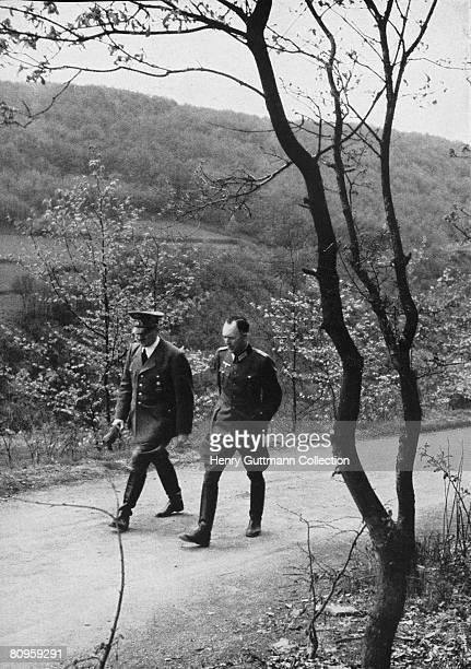 Nazi leader Adolf Hitler with his chief adjutant Lieutenant Colonel Rudolf Schmundt near a Fuhrer Headquarters in Germany circa 1940
