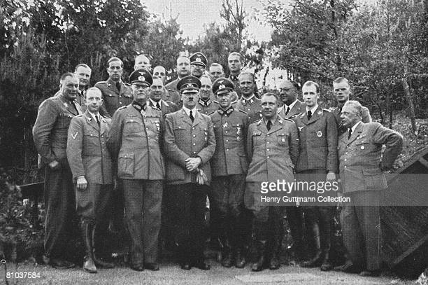 Nazi leader Adolf Hitler with the permanent staff of the Felsennest the Fuhrer Headquarters near Bad Munstereifel Germany circa 1940 Hitler used the...