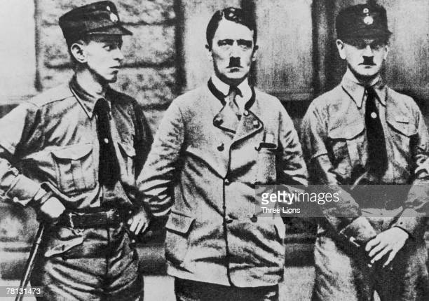 Nazi leader Adolf Hitler with two members of the party's paramilitary wing, the SA, 1923.