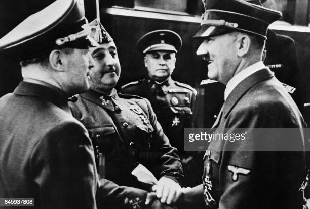 Nazi leader German Chancellor Adolf Hitler shakes hands with Spanish Generalissimo Francisco Franco at Hendaye train station on the FrenchSpanish...