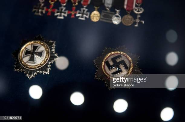 Nazi medals can be seen during a preview at the Zeitgeschichtliches Forum in Leipzig Germany 16 March 2017 The exhibition titled 'Ab morgen...