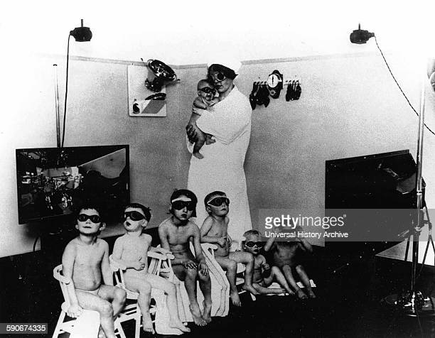 """A Nazi nurse with """"German super race"""" children whom Nazi scientists tried to lighten their hair and eyes to a more Aryan appearance"""