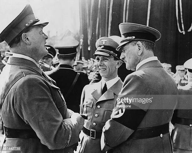 Nazi officers in conversation Hermann Goering Joseph Goebbels and Franz Ritter von Epp as they wait for Hitler to speak at the Nazi Party rally...