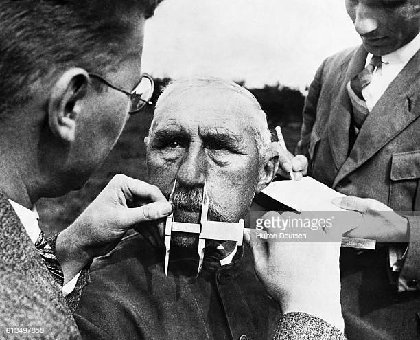 Nazi officials use calipers to measure an ethnic German's nose The Nazis developed a system of facial measurement that was supposedly a way of...